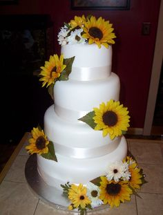 A family member was married this weekend and asked for a sunflower and daisy themed wedding cake.  I went with 12, 10, 8  6 pans.  She asked me to make the flowers initally but after seeing the time and cost, said silk would be okay!
