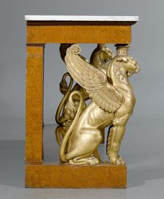 """c1815-25 NARROW CONSOLE """"AUX LIONS AILES"""",  Empire/Restauration, attributable to F.H.G. JACOB-DESMALTER (François Honoré Georges Jacob Desmalter, 1770 Paris 1841), Paris ca. 1815/25.  Grained amboine, opulently carved and parcel-gilt. Fine, gilt bronze mounts and applications. """"Carrara"""" marble top. Some losses.  206x51x89 cm.  Sold for CHF 25 000 (hammer price)"""