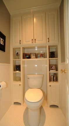Built-ins surrounding toilet, to utilize space that usually ends up being wasted, plus, it's a tricky area to keep squeaky clean. It's a great storage solution.
