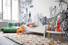 Amazing jungle mural adds adventure to this beautiful child's room!  #estella #kids #decor