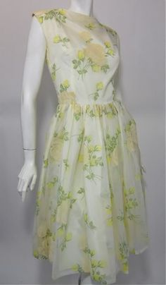 60s soft white chiffon over taffeta  party dress with bright yellow and  ivory print and flocked rose print.