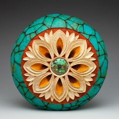 """""""Flower"""" gourd art, 10""""h x 10""""w x 4""""d. Carving by Mark Doolittle; paper applique by Kathy Doolittle. George Post, photography."""