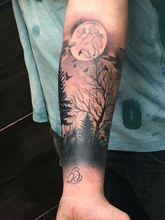 tatuajes de paisajes en el brazo de noche