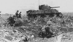 A Marine tank-infantry team advances during the Battle for Tinian. #marines #history #USMC #world war II