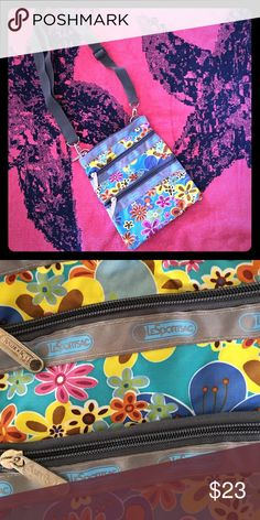 Le Sportsac small cross-body bag Le Sportsac small cross-body bag!  Super cute floral pattern🌸; 3 zippered pockets; received as a gift but has never been used - cute but not my style LeSportsac Bags Crossbody Bags