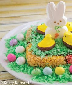 Blow everyone away at your Easter dinner with this Rice Krispies and Candy Cake for dessert! Your kids can get super creative with the holiday-scene cake topper!