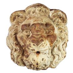 This cast iron lion head, with its original paint surface, once adorned a building in the Midwestern US.
