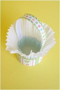 CUTE Tutorial on how to make    These mini Easter baskets from Anjeanette of Roots and Wings Co. are so clever. They use cupcake liners and are just the perfect size for an individual Easter egg, whether plastic or real! Give as favors or write names on the plastic Easter eggs and use for decorative Easter place-cards.