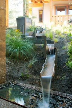 What a great waterfall by Shades Of Green Landscape Architecture