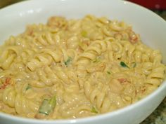 A 5-star recipe for Creole Crawfish Monica made with rotelle pasta, butter, heavy cream, Cajun seasoning, green onions, crawfish