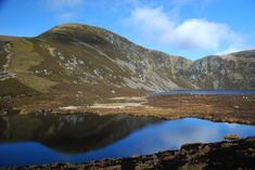 Loch Brandy is a superb example of a mountain corrie, backed by craggy slopes and cradling a perfect loch. The walk has the benefit of a very well constructed path making this a good short and relatively easy hillwalk.