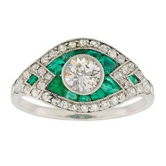 Emerald and Diamond Cluster Ring | From a unique collection of vintage cluster rings at http://www.1stdibs.com/jewelry/rings/cluster-rings/