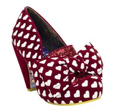 You'll be head over heels for the One Love Heels from Irregular Choice! These funky pumps feature an all-over velvet heart print in deep red and purest white--a romantic, retro-inspired pattern that calls to mind the bold shoe designs of the 1970s. With a glittery red vamp and an oversized bow perched on the toe, there's no better way to make a statement when you step out in your favorite Trashy Diva outfit!