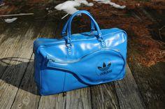 70s electric blue Adidas tennis racket bag vinyl gym bag travel luggage. $125.00, via Etsy.