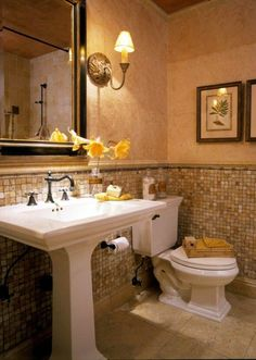 Great tile work and warm colors make the guest bathroom inviting.  I love how the handmade wallpaper gives it a European flair!
