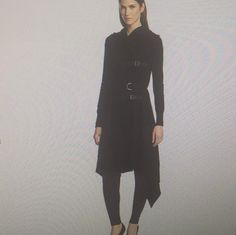 Edgy long knit cardigan with adjustable buckle closure , optional belt , attached hood and dramatic hsndkerchief hem . Fabric 60% cotton ,30% nylon,10% wool . Fun !!