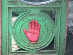 I have always been intrigued by this symbol.     Red hand of Ulster, Belfast  Photography by flickr/Sheila Fitzgerald