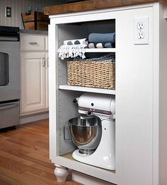 Try Open Storage Open cubbies provide an opportunity to store pretty items and to introduce an accent color in a white kitchen. The basket adds texture and storage. Blue kitchen accents give a white kitchen a little pop of color.