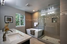 Master Bathroom with Undermount Sink, Freestanding Bathtub, Complex marble counters, frameless showerdoor, Double sink