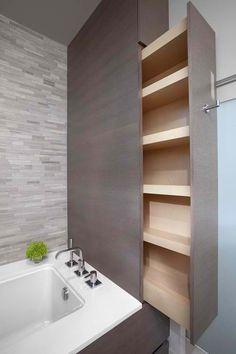 Great design idea for the bathroom, a pull out cabinet