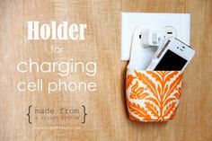 Oh my goodness!  My aunt had one of these and now I just found a tutorial.  It's a Holder for Charging Cell Phone.  Made out of old plastic bottle mod podge and fabric.