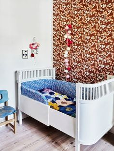 Beauty sleep - Frame the sleeping area in the kids room with some floral wall paper or wall paper with print after your child's wishes, and create different areas in the room.