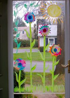 How to Make Your Own Sunshine - Have kids paint several coffee filters with watercolor paint — the brighter, the better! Once the filters are completely dry, cut them out to look like flowers! When dry attach them to a glass door or window. I used acrylic paint to fill in the stems, leaves, and sun. Instant sunshine!!!