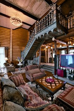This large 640 square meter house is located in Novokuznetsk, Russia. It's designed by Tatiana Rozhkova as a Russian fairy tale that meet all modern requirements for comfortable living. The house is made with Siberian firm and quality of pine logs of 260 mm. The living room is flooded with sunlight thanks to the thoughtful architecture of the home. The fireplace is the main focal point of this room. It's seven meters in height and tiles with porcelain tiles. Each of its four sides has its…