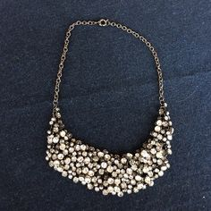 Urban Outfitters Glitter Bib Necklace Urban Outfitters Glitter Bib Necklace gun metal small link details and clasp closure. Perfect when an outfit needs a pop of shimmer, glitter, and sparkle. Gently worn, no signs of wear. Urban Outfitters Jewelry Necklaces