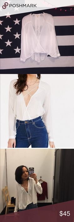 Urban Outfitters white surplice top Urban Outfitters surplice white top! Brand new, worn to try on, great condition! Free the nipple in this gorgeous top or pair with a super cute bralette! Urban Outfitters Tops Blouses
