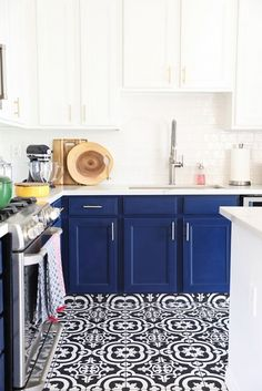 Grey and gold kitchen cabinets navy blue kitchen cabinets black and white tile floor and gold . grey and gold kitchen cabinets Kitchen Cabinets Black And White, White Kitchen Floor, Blue White Kitchens, White Kitchen Cabinets, Navy Cabinets, Kitchen Modern, Kitchen Paint, Bathroom Cabinets, Ikea Cabinets