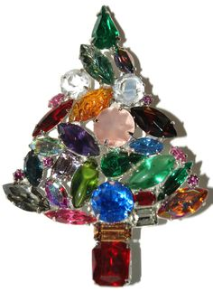 The Christmas tree pin is marked deLillo in a cartouche. The tree has a variety of colors, shapes and stones. Four of the stones are open backed.
