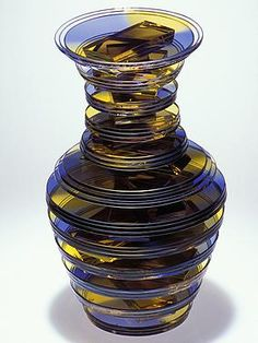 Sidney Hutter sculpted  the Twisted Vase series using polished circles, plate glass bars, uv adhesive and dye.