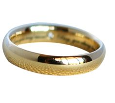 Classic yellow gold with interior diamond accent and engraved LoveNote custom wedding band. Custom wedding ring by Abby Sparks Jewelry, custom jewelry designer in Denver, Colorado.