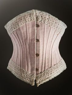 68d607842c An English pink cotton corset dated from 1890-1895. The corset has been an