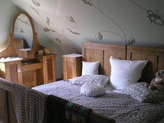 Ložnice se zkosenou stěnou