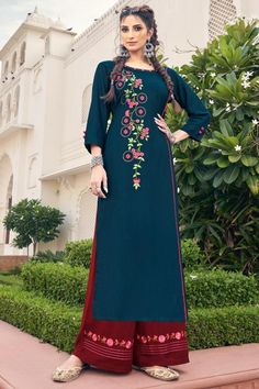 Bright and appealing, this dark blue rayon trouser suit which will instantly catch your fancy. This round neck and 3/4th sleeve suit decorated using resham work. Completed with rayon palazzo pant in dark maroon color with dark maroon chiffon dupatta. Palazzo pant has resham work. Dupatta highlighted with plain work. #trousersuit #salwarkameez #malaysia #Indianwear #Indiandresses #andaazfashion Indian Dresses, Indian Outfits, Blue Dresses, Indian Clothes, Blue Trousers, Trouser Suits, Palazzo Suit, Kurta Palazzo, Women Salwar Suit