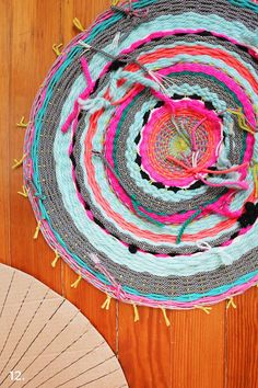 Cheery DIY woven rug by A Beautiful Mess