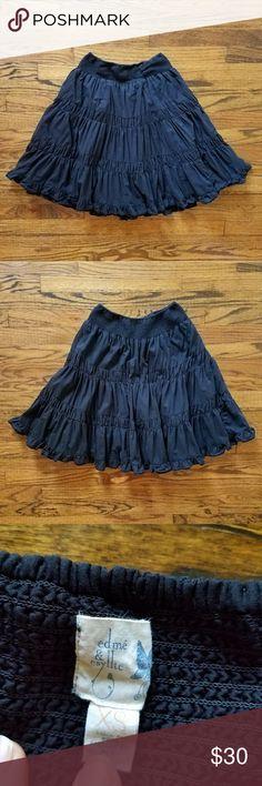 "Edme & Esyllte black full boho skirt Lined full black boho skirt. Elastic waistband gives the waist some stretch. Flirty ruffle bottom hem. Measurements are 24"" waist and 22"" length. Excellent used condition. Anthropologie Skirts"