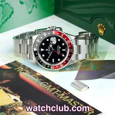Rolex GMT-Master II Coke Bezel - 'Compete Set' REF: 16710 | Year May 2006 - This UK retailed GMT-Master II 'Coke bezel' is in superb condition, and complete with original box and papers...The original pilots watch, these GMT ref.16710's are in such high demand, and prices are rising steadily. Powered by Rolex's chronometer rated automatic dual time movement (cal.3185), fitted to a rugged Oyster bracelet and waterproof to 100m - for sale at Watch Club, 28 Old Bond Street, Mayfair, London