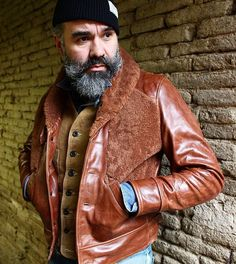 """Everyone's favourite """"Pop Dadaist"""" artist, good ol' Mr French Can Can @abauville in his proto winter 17/18 SJC Hill Climber Grizzly, coming this year. Check out his excellent blog www.frenchcancan #sjc #simonjamescathcart #leatherjacket #biker #rider #vintagemotorcycle #rideordie #vintageleatherjacket #style #french #artist #badass #glue #newspaper #designer #beard #beards #furryfrog"""