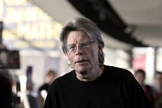 American author Stephen King drop a bucket on Donald Drumpf Photo credit should read KENZO TRIBOUILLARD/AFP/Getty Images)