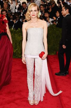 Diane Kruger in a stunning all-white embroidered Chanel Haute Couture top and pants and bold red lip at the 2015 Met Gala