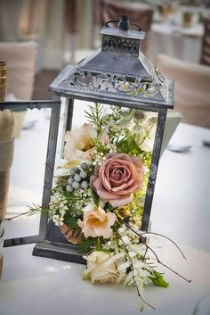 18 DIY Wedding Centerpieces on a Budget! 18 DIY Wedding Centerpieces on a Budget! Lantern Centerpiece Wedding, Centerpiece Ideas, Centerpiece Flowers, Wedding Table Centrepieces, Vintage Centerpieces, Flower Table Decorations, Rustic Candle Centerpieces, Vintage Table Decorations, Silver Decorations