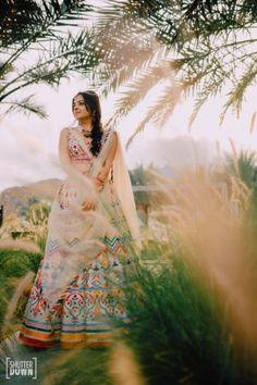 Destination wedding in Fujairah with bride in orange Sabyasachi lehenga Sharara Designs, Lehenga Designs, Mirror Work Lehenga, Haldi Ceremony, Pink Lehenga, Big Fat Indian Wedding, Bollywood Girls, Sabyasachi, Bride Look