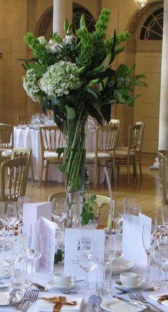 Tall tablecentres created elegant displays in this Autumn wedding. Antique hydrangeas were the star flower.