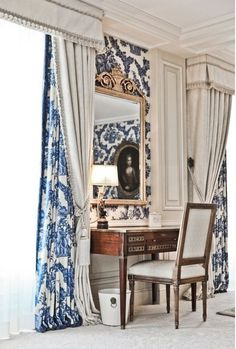 Love the drapery fabric and style