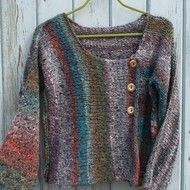 Five skeins of Noro Kogarashi yarn were used to hand knit this lovely sweater. The yarn is soft and luxurious, with a 51% silk and 49% wool content. I particularly love this colourway and it fully displayed in the panels which are orientate in three di...