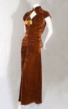 rouched velvet gown with corsage
