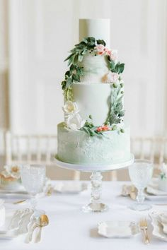 Mint green wedding cake with floral foliage wreath  Photography www.plentytodeclareweddings.com